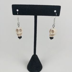 Skull earrings made with black faceted beads